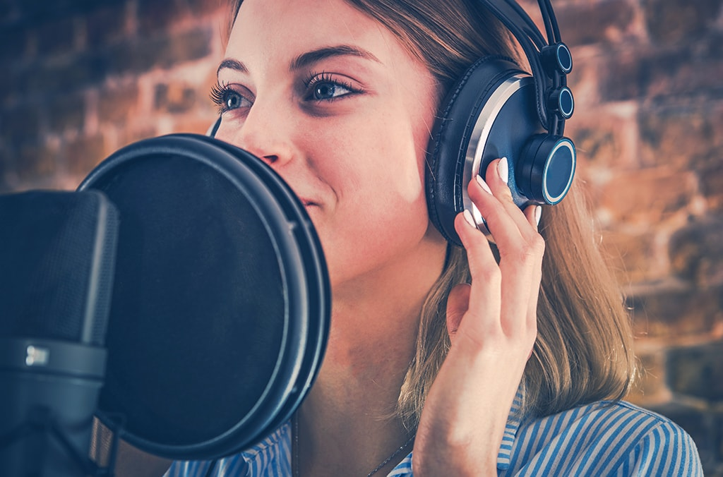 vocal recording in the booth for singers and voice over with headphones
